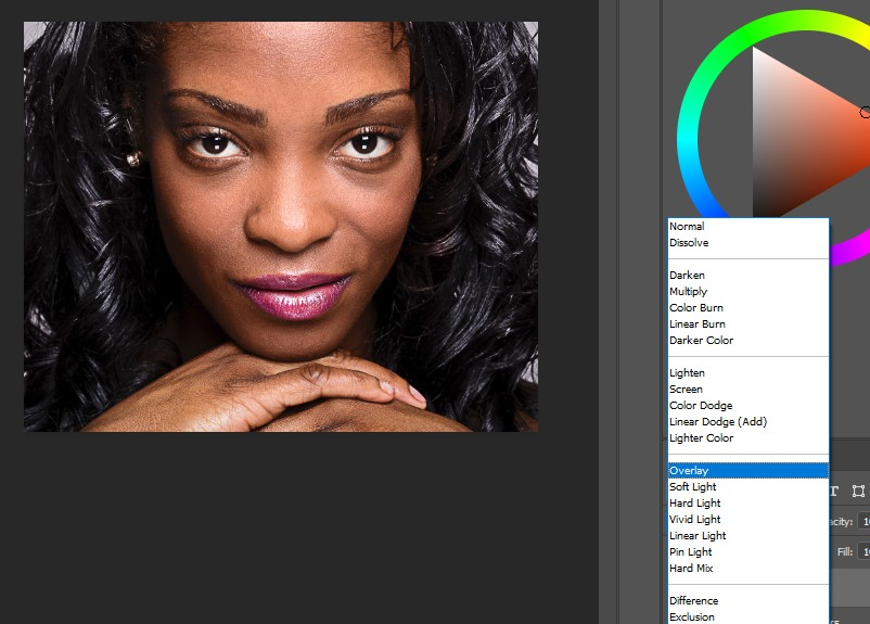 change the blend mode of the layer to Overlay.